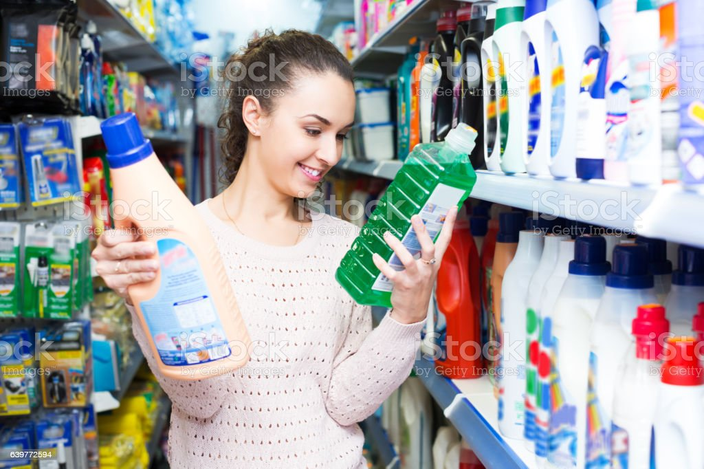 Girl selecting fabric conditioner stock photo