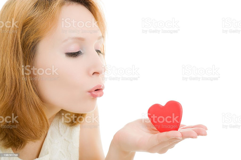Girl sends an air kiss in the form of heart royalty-free stock photo