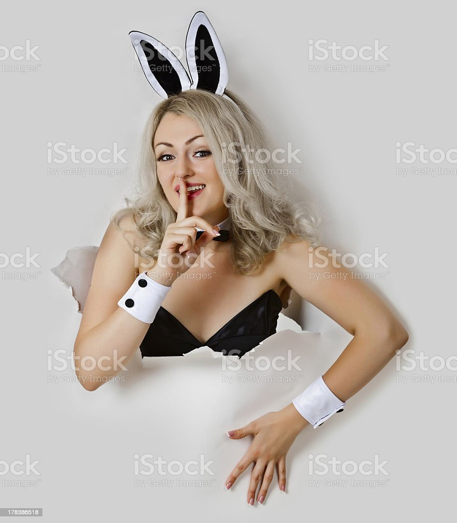 Girl - sexy rabbit playful looks from a hole stock photo