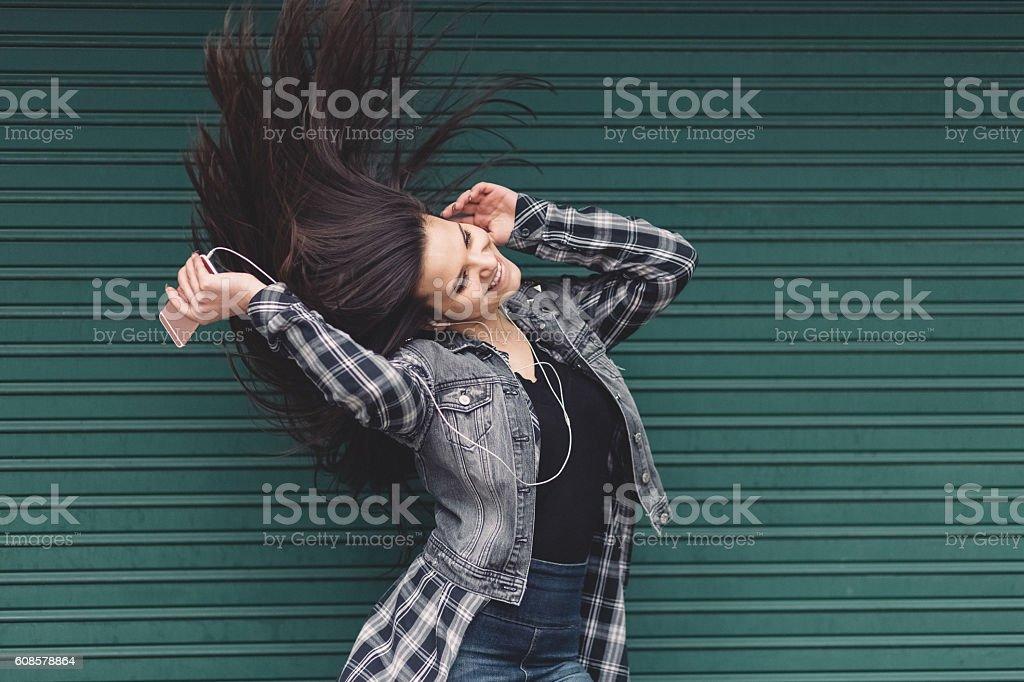 Girl shaking head to music stock photo