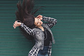 Girl shaking head to music