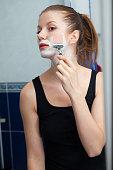 Girl shaving in bathroom
