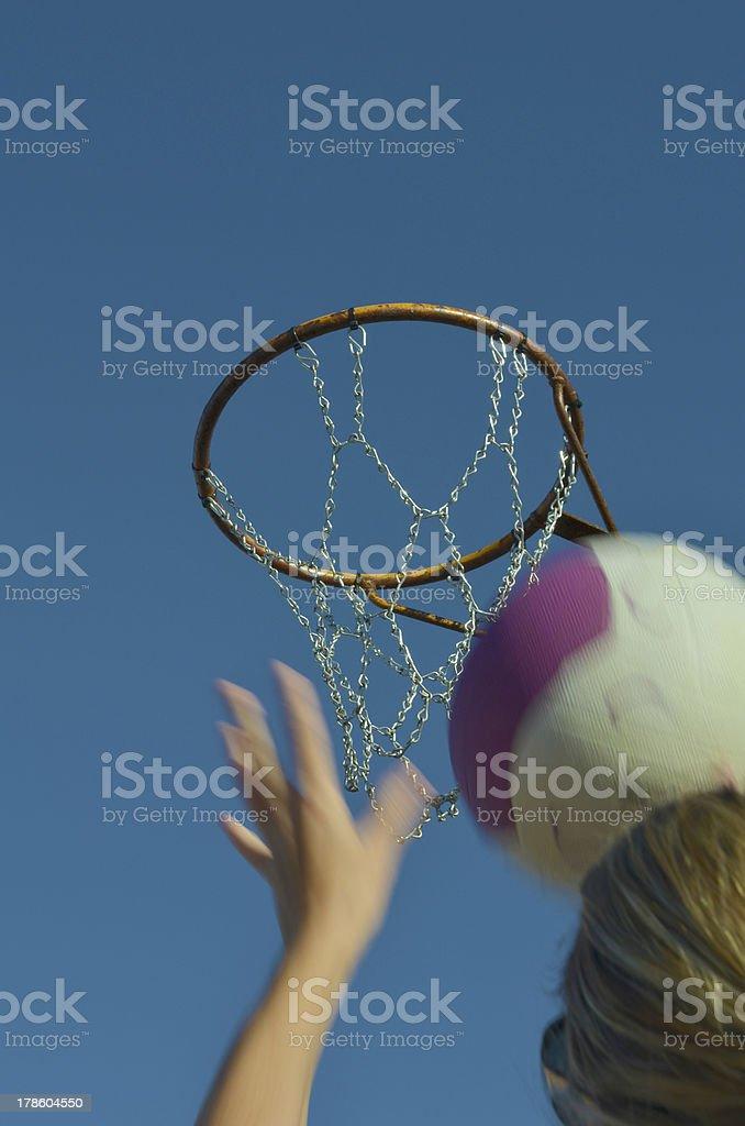 Girl shooting a netball goal royalty-free stock photo