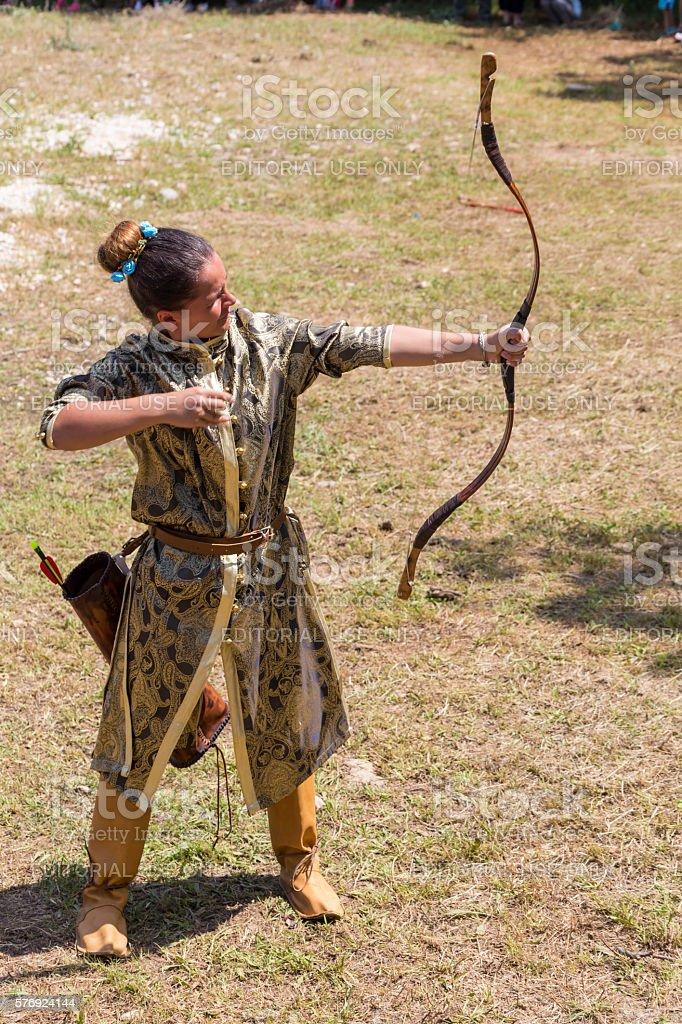 Girl shooting arrows stock photo