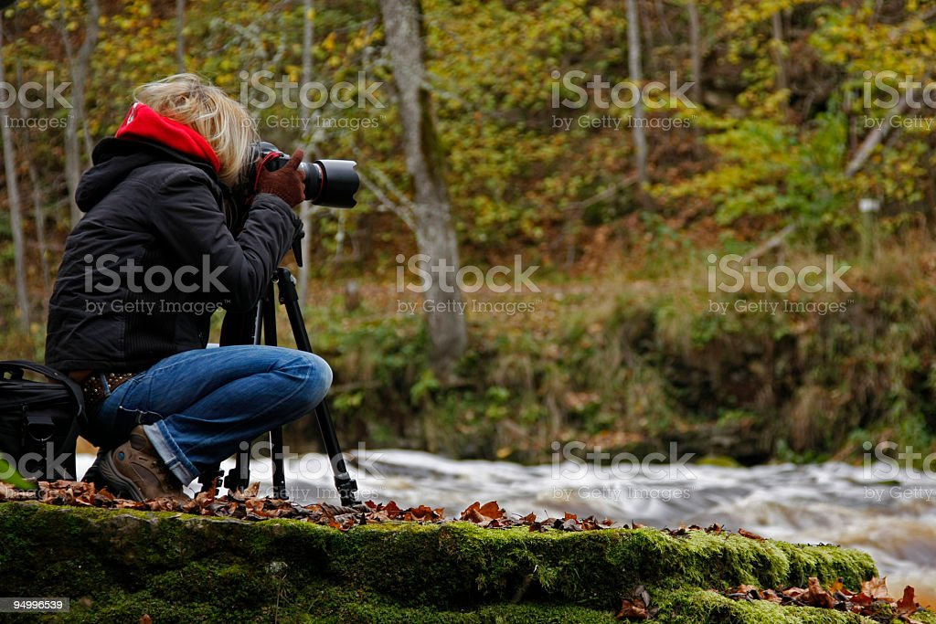 Girl shooting nature royalty-free stock photo