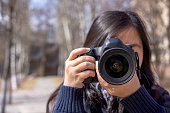 girl shooting pictures