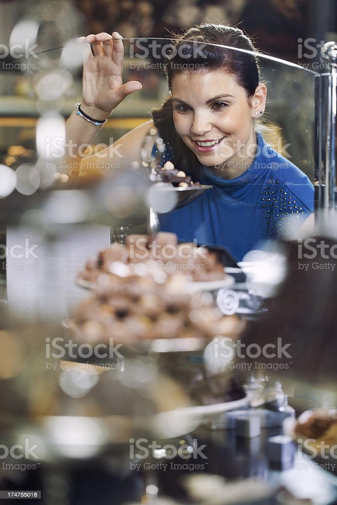 girl shopping and admireing  different chocolate goodies stock photo