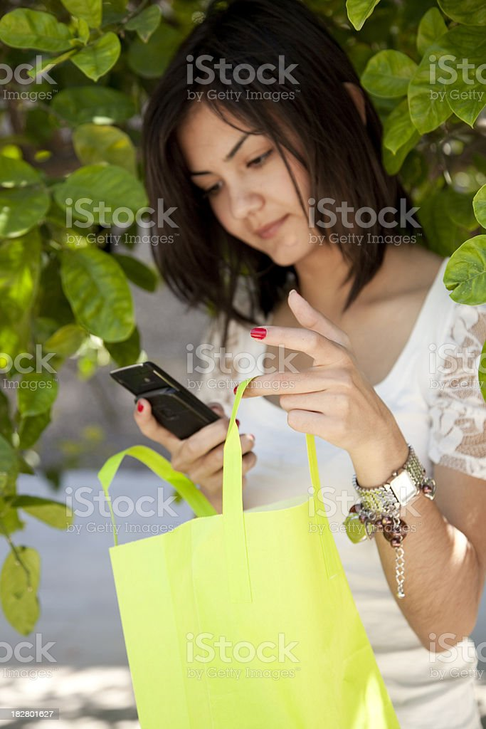girl shopping and carrying bags stock photo