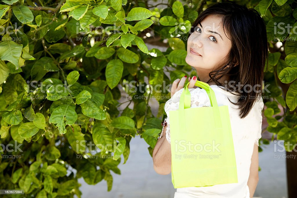 girl shopping and carrying bags royalty-free stock photo