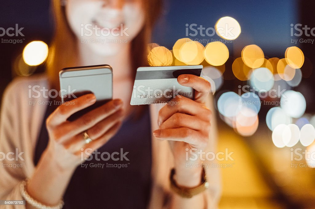 Girl shopping online with credit card stock photo