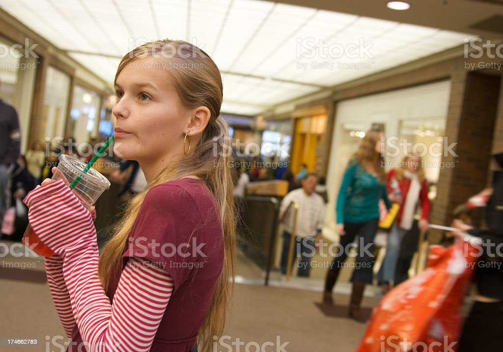 Girl Shopping with a Drink royalty-free stock photo