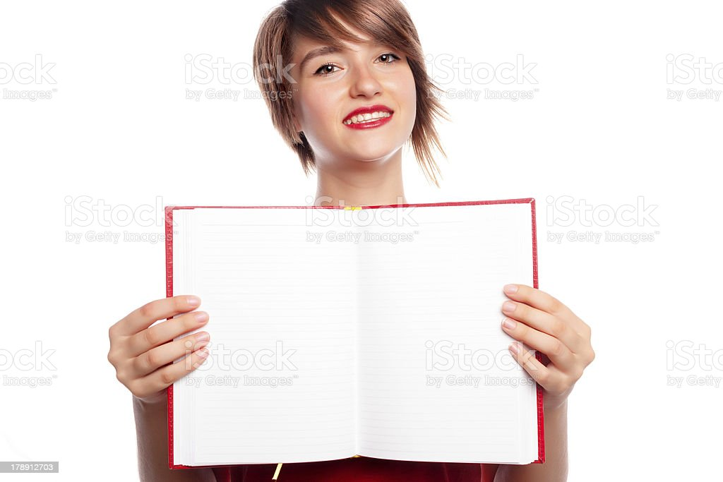 Girl showing blank paper in book royalty-free stock photo
