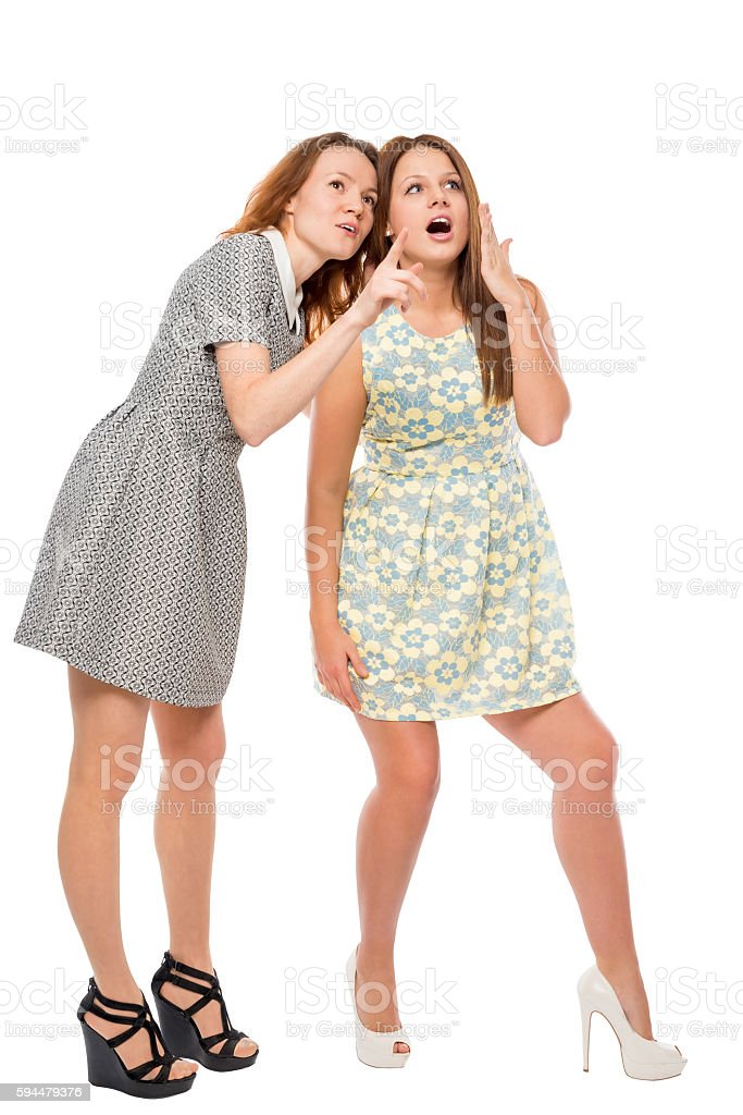 girl showing her friend something amazing on a white background stock photo