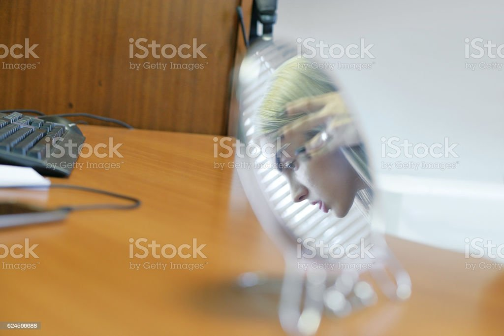 Girl showing her tongue in mirror reflection stock photo