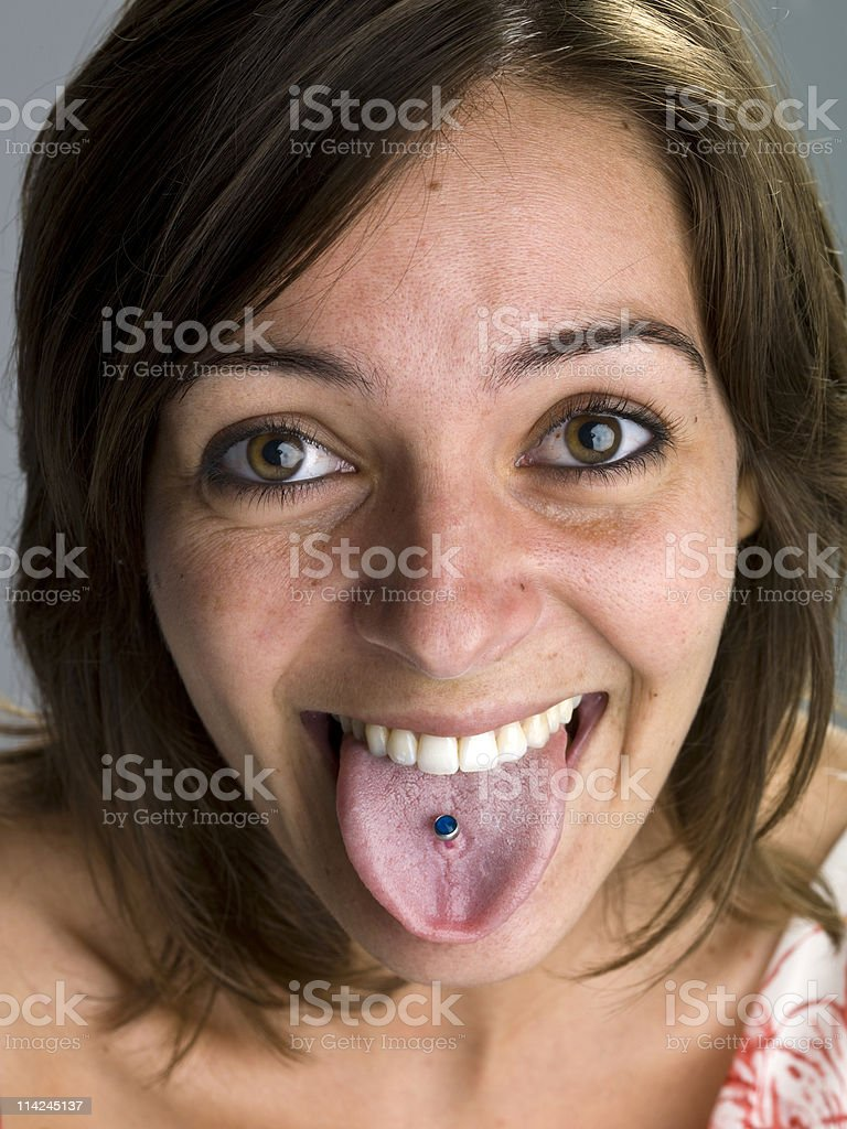 Girl showing her tongue piercing royalty-free stock photo