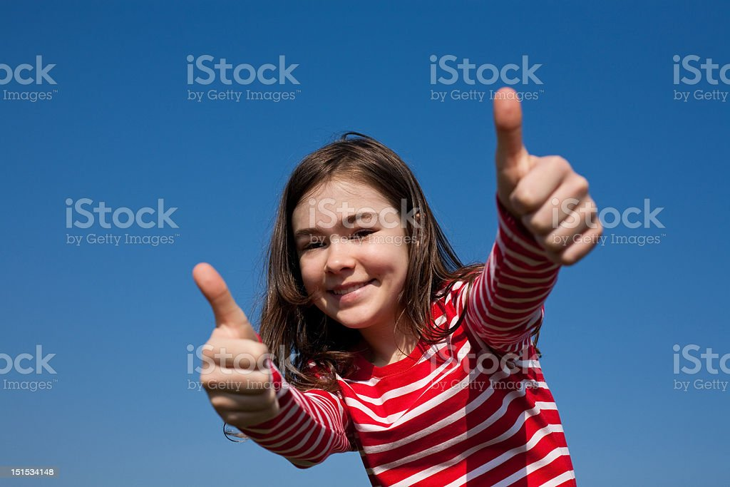 Girl showing Ok sign outdoor royalty-free stock photo