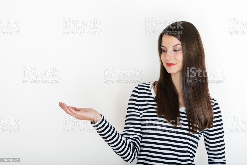 Girl showing open hand palm for text or product advert stock photo