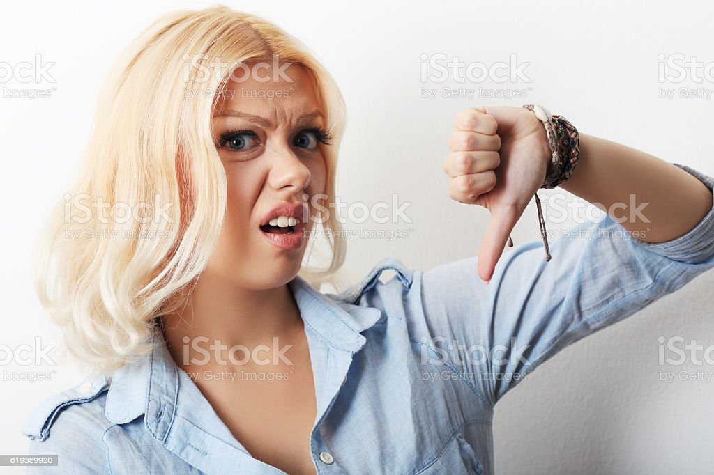 girl showing thumb down stock photo