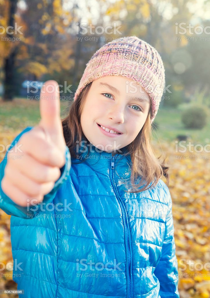 Girl showing thumb up royalty-free stock photo