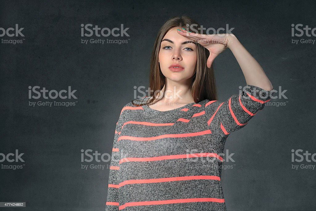 Girl shows anxiety against a dark background stock photo