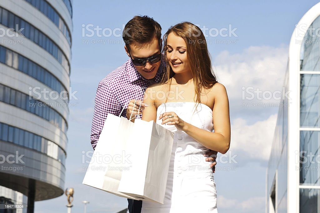 Girl shows her boyfriend to buy royalty-free stock photo