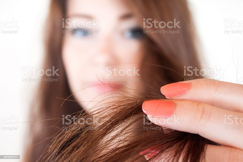 Girl shows her damaged hair stock photo
