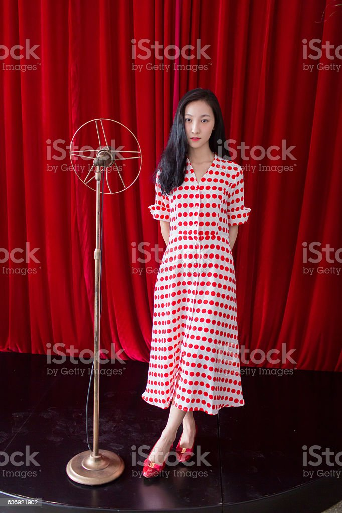 girl singing on stage stock photo