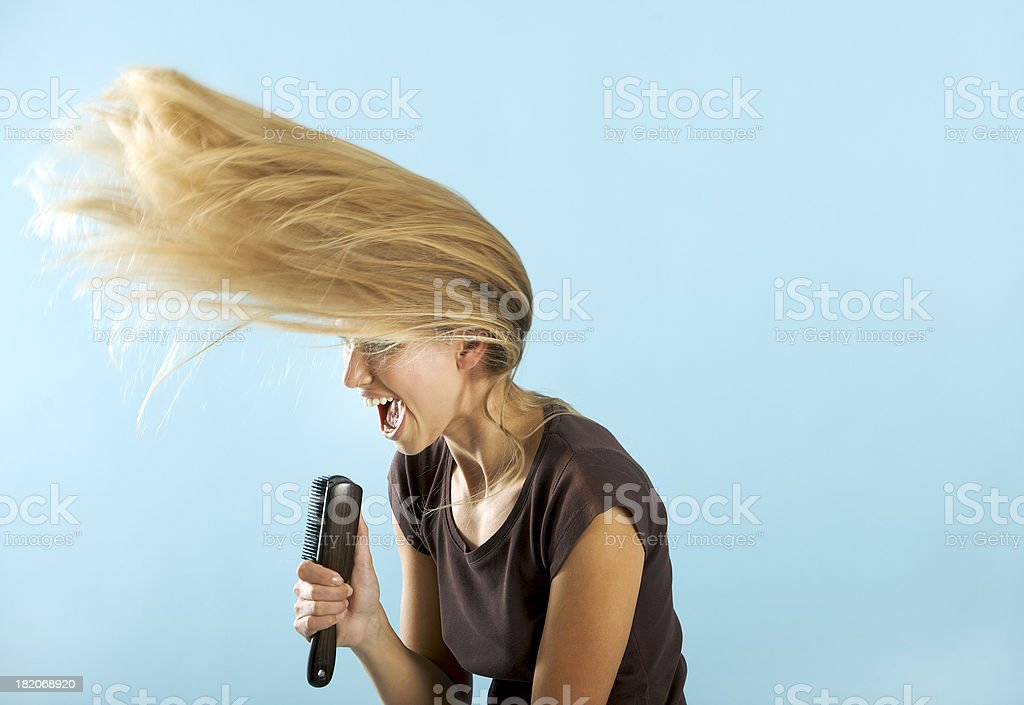 Girl singing on the hair brush stock photo