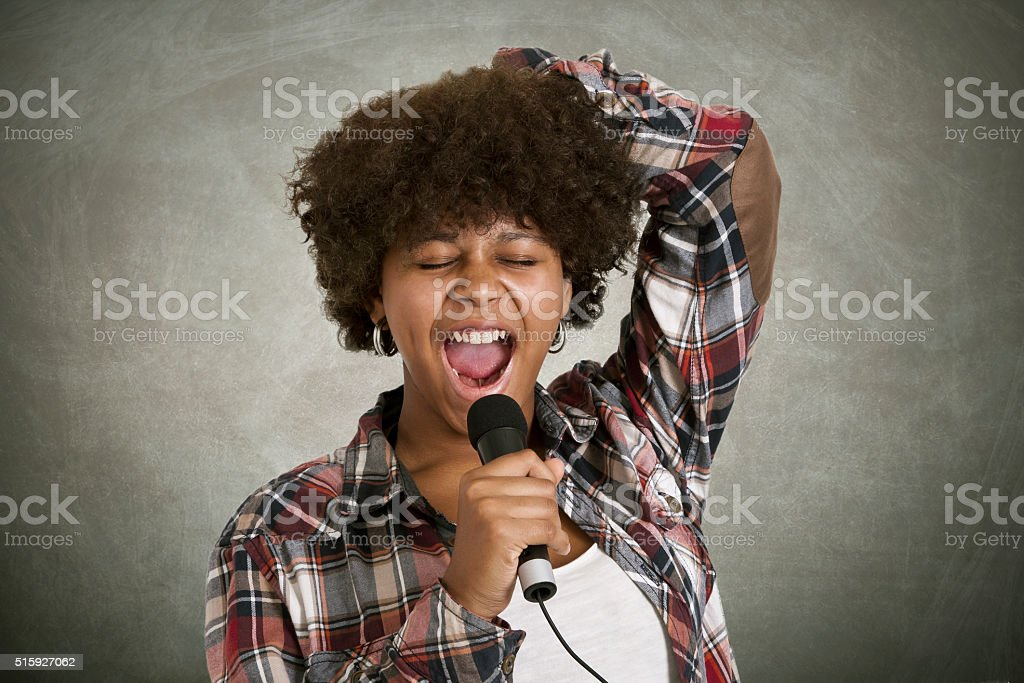 Girl singing with backlights stock photo
