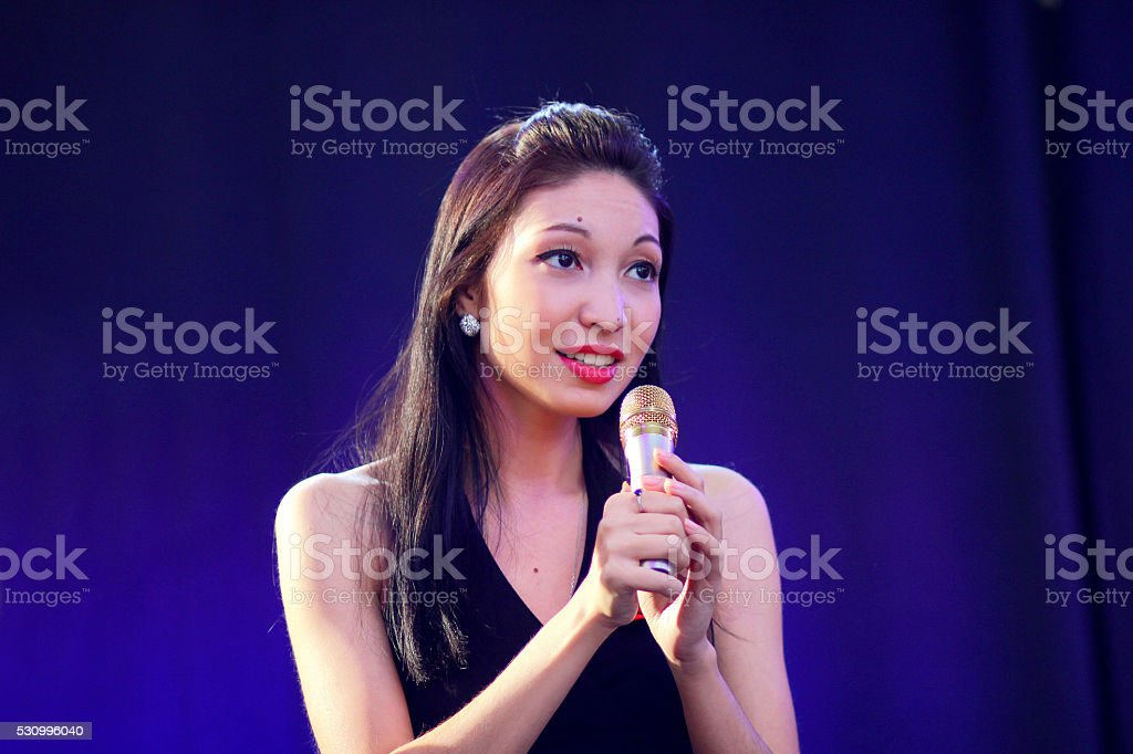 Girl sings on a stage stock photo