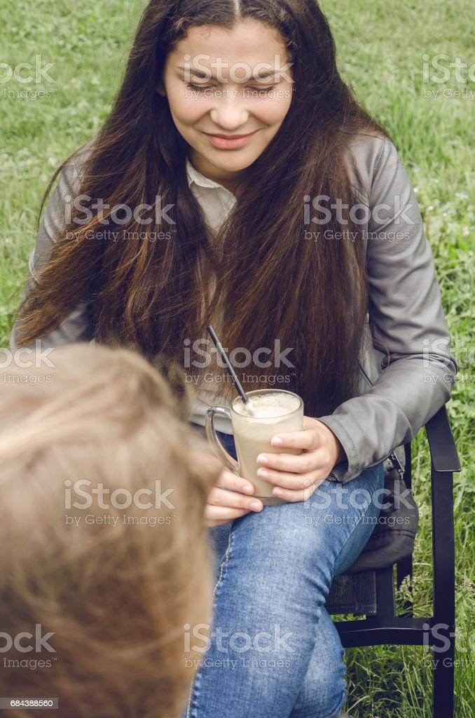 girl sits and speak with life coach in nature stock photo