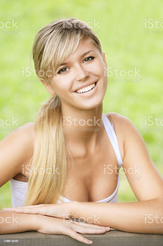 Girl sits on bench royalty-free stock photo
