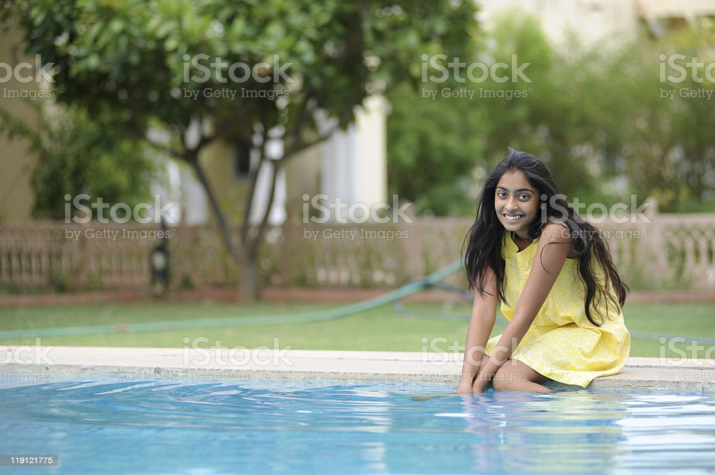 girl sitting at pool royalty-free stock photo