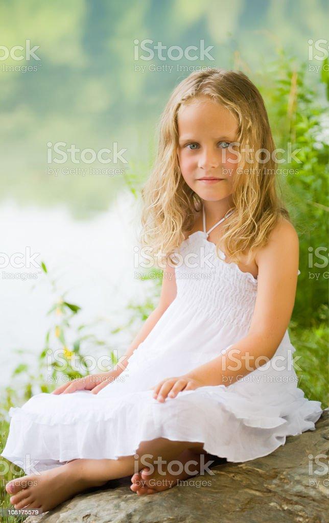 Girl Sitting by Lake royalty-free stock photo