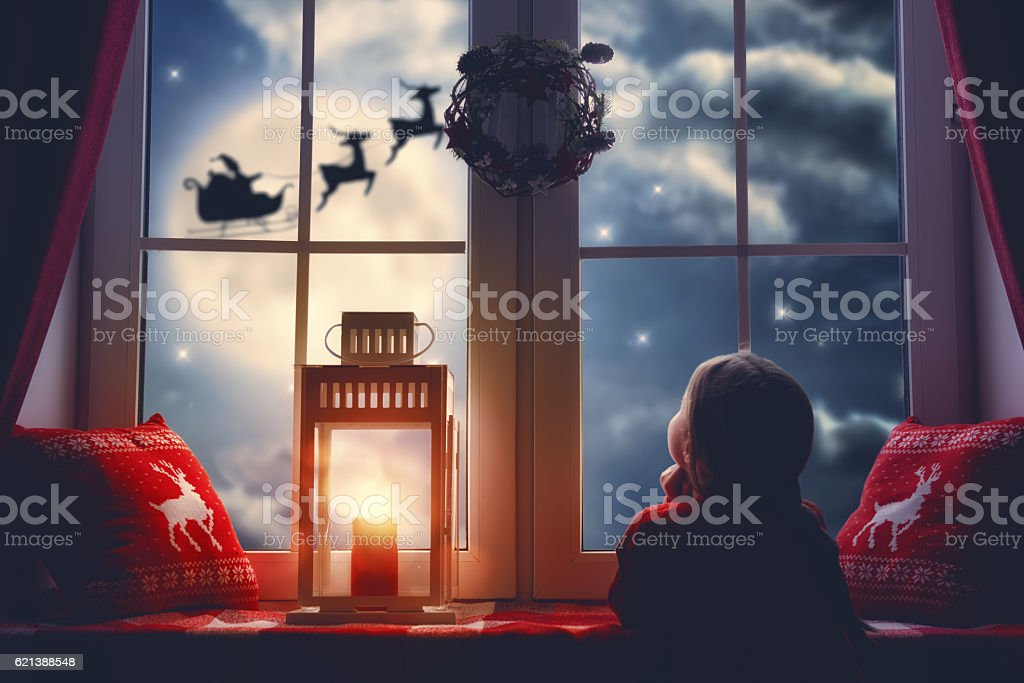 girl sitting by the window stock photo