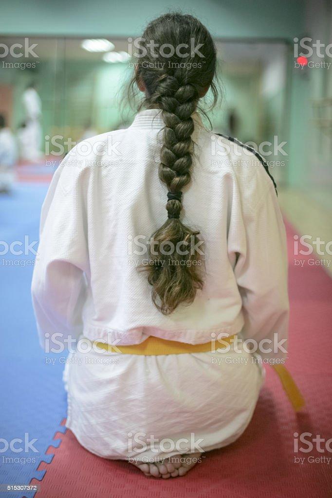 Girl sitting from back in her kimono stock photo