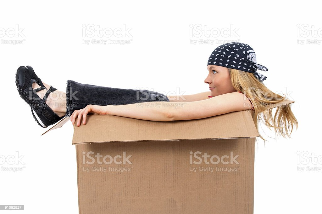 Girl sitting in a cardboard box royalty-free stock photo