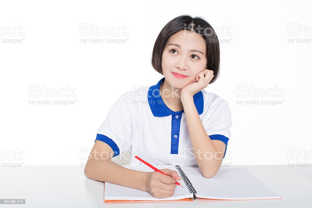 girl sitting in a classroom stock photo