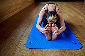 Girl sitting in a yoga pose gym. Relaxation meditation health