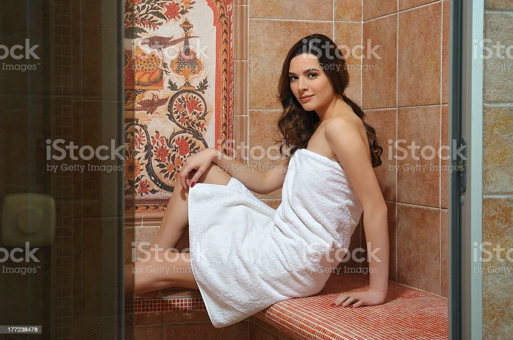 Girl sitting in hammam steam royalty-free stock photo