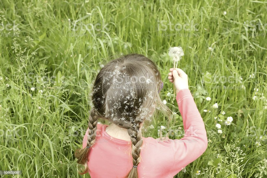 girl sitting in the grass stock photo