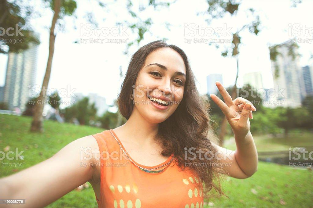 girl sitting in the park of Kuala Lumpur on stock photo