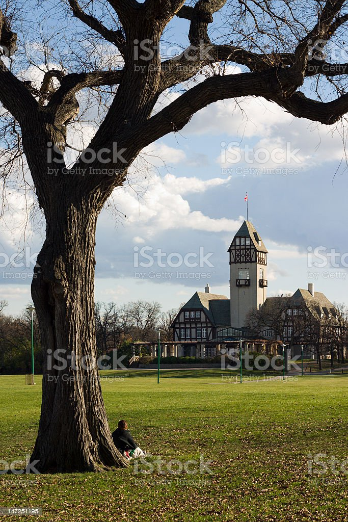 Girl Sitting in the Park Under Tree stock photo