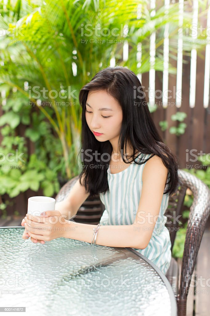 girl sitting on a bamboo weaving chair stock photo