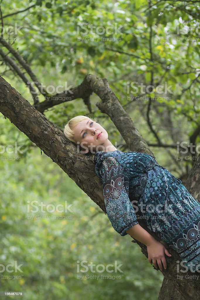 girl sitting on a branch royalty-free stock photo