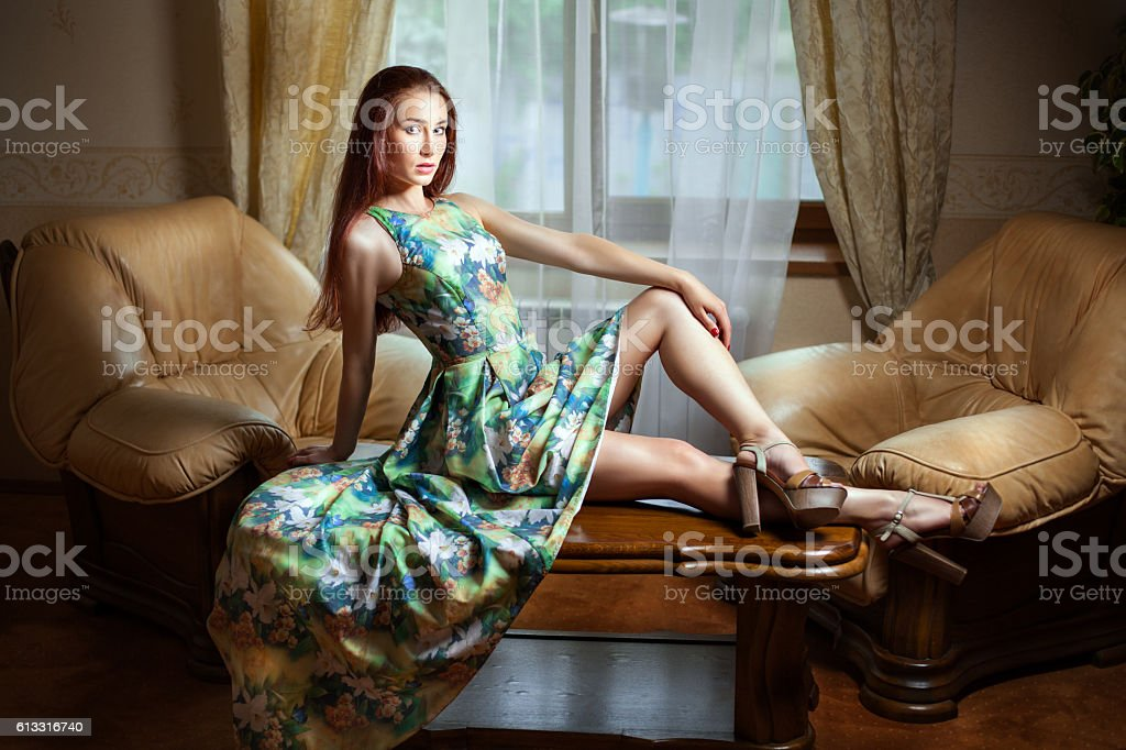 Girl sitting on a desk. stock photo