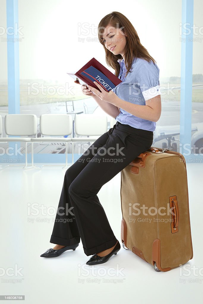 Girl sitting on a suitcase royalty-free stock photo