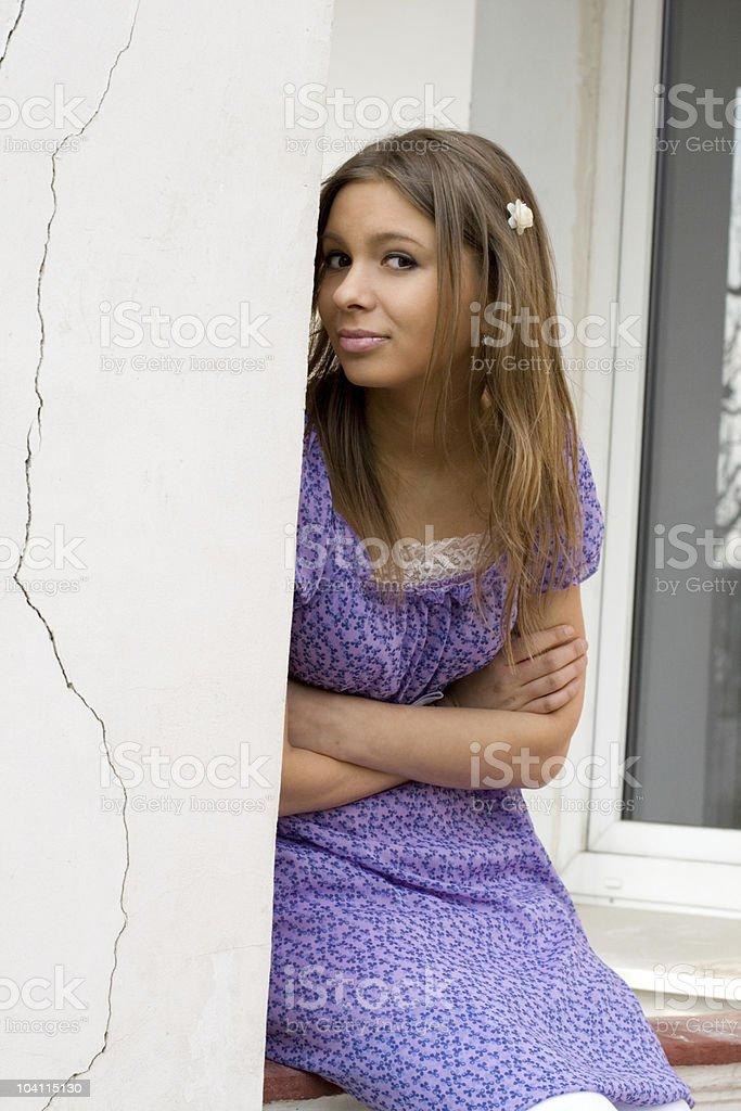 Girl sitting on a veranda royalty-free stock photo