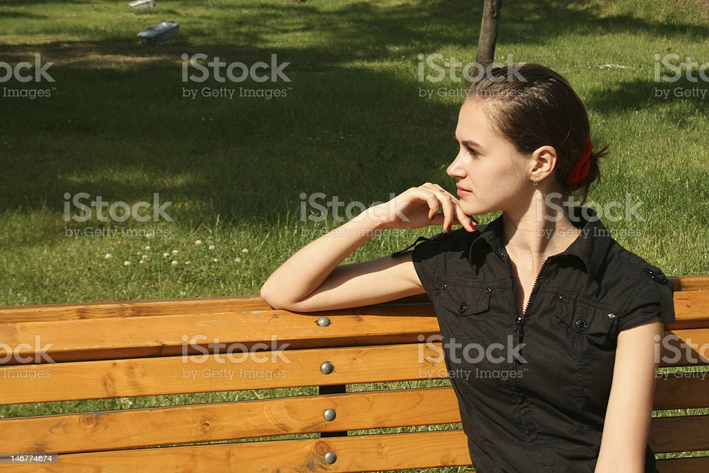 Girl sitting on bench royalty-free stock photo