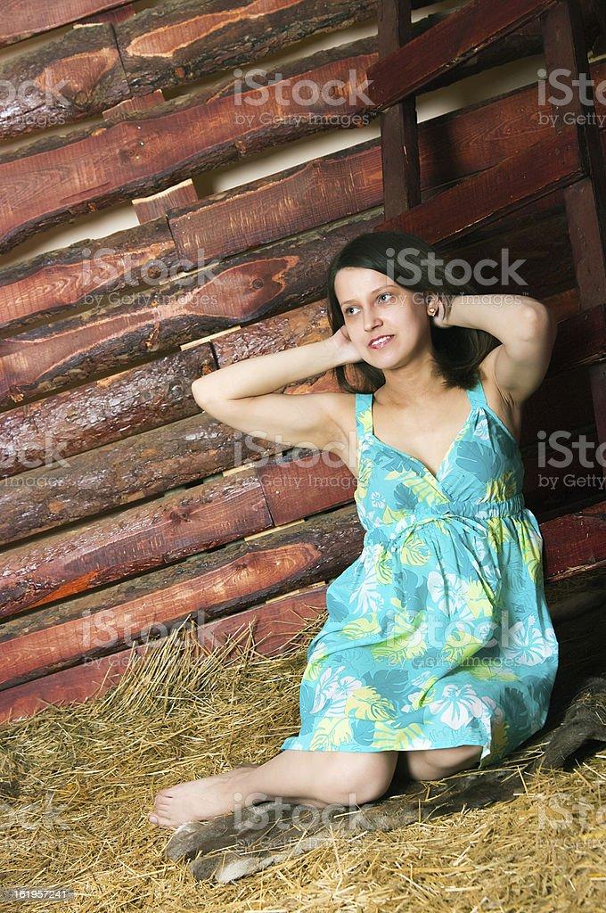 girl sitting on hay royalty-free stock photo